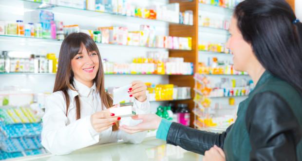 pharmacist suggesting medical drug to buyer in pharmacy drugstor
