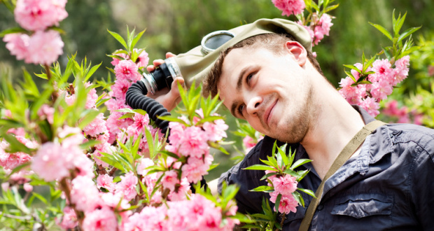 Man in the mask on the flowers background